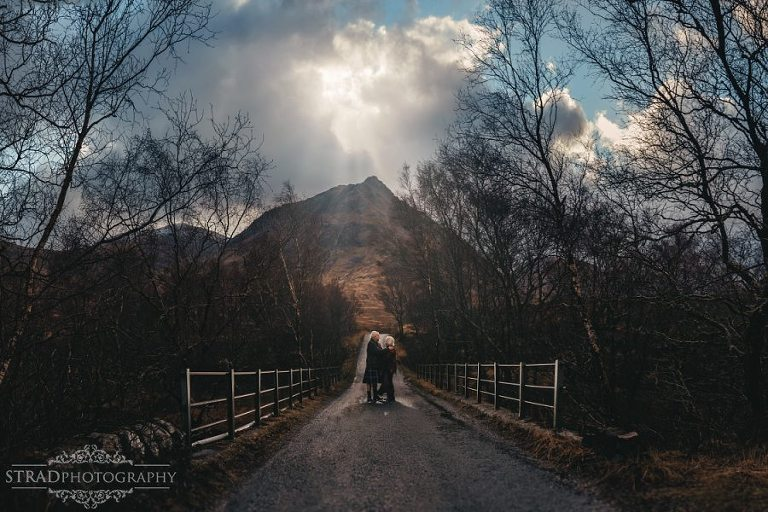 beautiful scenery, elderly couple, engagement photography, glen etive, Glencoe, grandma, grandpa, hiking, kilt, senior couple, marriage, old couple, old married couple, older couple photoshoot in Glencoe Scotland, outlander, poncho, posing ideas, scotland, scottish couple, scottish highlands, senior couple, tartan