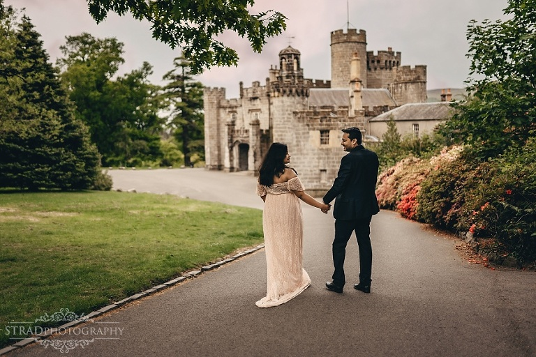 pregnant woman and her husband walks near Balloch Castle