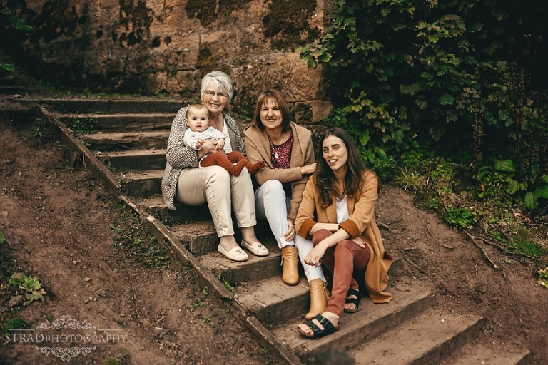 Portrait of 4 generation of women sitting on the stairs